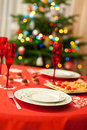 Decorated christmas table with champagne glasses Royalty Free Stock Photo
