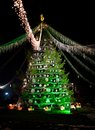 Decorated christmas tree christmass with green tinsel lights and bells in the centre of the city Stock Photo