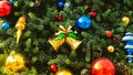 Decorated christmas tree with colorful christmas ball and gold bell adorn colourful golden Stock Photography