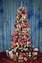 Decorated christmas tree with electric candles and presents Royalty Free Stock Photo