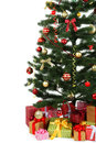 Decorated christmas tree with gifts on white background, close up