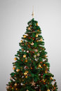 Decorated christmas tree on grey background Stock Image