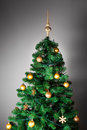 Decorated christmas tree on grey background Royalty Free Stock Photos
