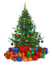 Decorated Christmas tree with heap of gift boxes Stock Photos