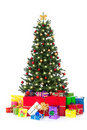Decorated christmas tree with many colorful gifts Royalty Free Stock Image