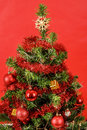 Decorated christmas tree on red background Royalty Free Stock Images