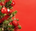Decorated christmas tree on red background Stock Photography