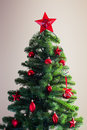 Decorated christmas tree with red ornament Royalty Free Stock Photo