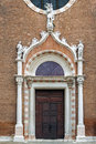 Decorated church doors in venice gothic italy Stock Photos