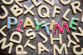 Decorated cookies playtime arranged to spell amongst plain ones Royalty Free Stock Photography