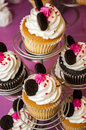 Decorated cup cakes close up of on a cake stand Stock Photography