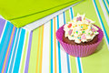 Decorated cupcake on stripy background Stock Image