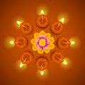 Decorated diwali diya on flower rangoli illustration of Stock Photography