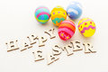 Decorated easter egg with wooden text Royalty Free Stock Photos