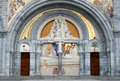 The decorated entrance of the Lourdes Basilica Stock Photography