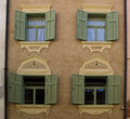 Decorated facade bolzano italy brown and green shutters Stock Photos