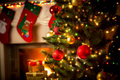 Decorated fireplace and Christmas tree at cottage Royalty Free Stock Photo