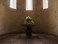 Decorated flower vase place on the altar in Swiss church. Royalty Free Stock Photo