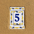 Decorated house number ceramics on the wall Royalty Free Stock Images