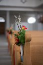 Decorated pew with beautiful flowers for wedding Stock Images