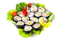 Decorated plate of sushi isolated on white background with clipping path Royalty Free Stock Photos