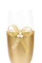 Decorated wedding golden glass wuth bow white background Stock Photos