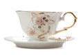 Decorated white tea cup and saucer. isolated Royalty Free Stock Image