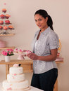 Decorating cakes happy young woman Royalty Free Stock Image