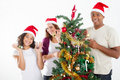 Decorating Christmas tree Stock Photo