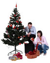 Decorating the Christmas tree Royalty Free Stock Photos