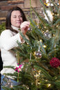 Decorating Christmas tree Royalty Free Stock Images