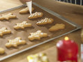 Decorating cookies close up chef with icing sugar Royalty Free Stock Photo