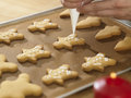 Decorating cookies close up chef with icing sugar Royalty Free Stock Photography