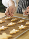 Decorating cookies close up chef with icing sugar Stock Images