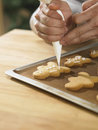 Decorating cookies close up chef with icing sugar Royalty Free Stock Image