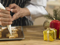 Decorating cookies with icing sugar chef Royalty Free Stock Images