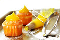 Decorating cupcakes with lemon curd Royalty Free Stock Image
