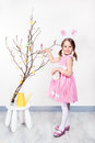 Decorating easter egg tree preschool girl with bunny ears Stock Image