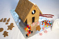 Decorating a Gingerbread House and Cookie Stock Photos