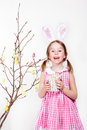 Decorating magnolia branch with easter eggs cheerful little girl tree Stock Photography
