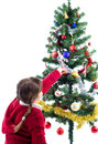 Decorating Xmas tree with candy Stock Photo
