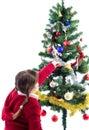 Decorating Xmas tree with candy Stock Photo