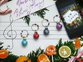 Decoration balls are arranged on the paper like music notes Royalty Free Stock Photo