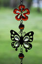 Decoration, green, red, decor, balance, window, mobile, wind, design, beauty, shell, hang, art, background, nature, butterfly Royalty Free Stock Photo