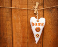 Decoration heart hanging on wooden background Royalty Free Stock Photos