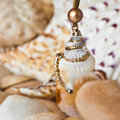 Decoration made of sea shell closeup jewellery from shells hanging on a string Stock Images