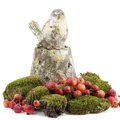 Decoration with moss, crabapples and a bird statue Royalty Free Stock Photography