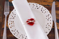 Decoration Saint Valentine's day: White plate serviette fork knife with handmade red crochet heart Royalty Free Stock Photo