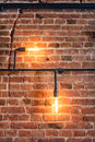 decoration walls with lamps, pipes and bricks. Old and vintage looking wall, interior design Royalty Free Stock Photo