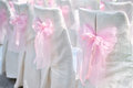 Decoration on wedding chairs pink bow Royalty Free Stock Photo